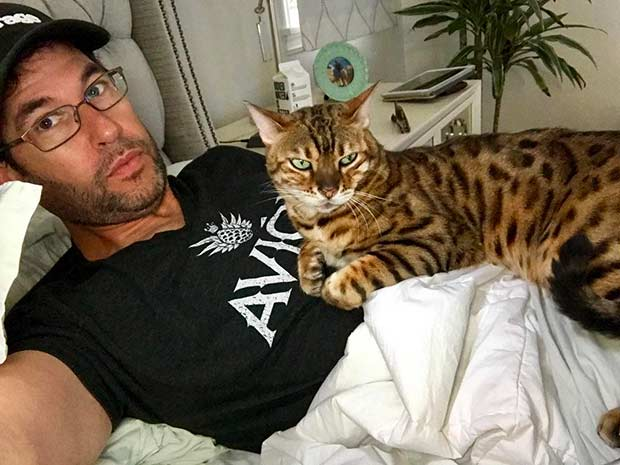 Doug Ellin with his Bengal Tex in bed